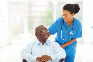 nurse providing care to senior patient with Parkinson's disease